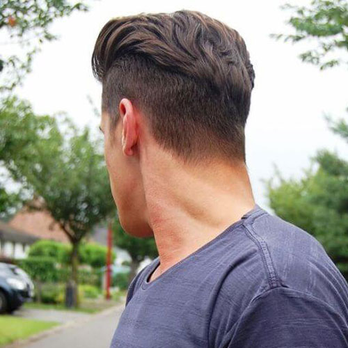 Textured Slicked Back Hair with Disconnected Undercut